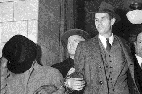 Alger Hiss in handcuffs - 1950